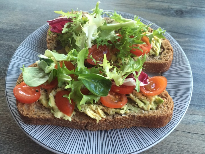 Avocado, tomato and hemp seeds on toast