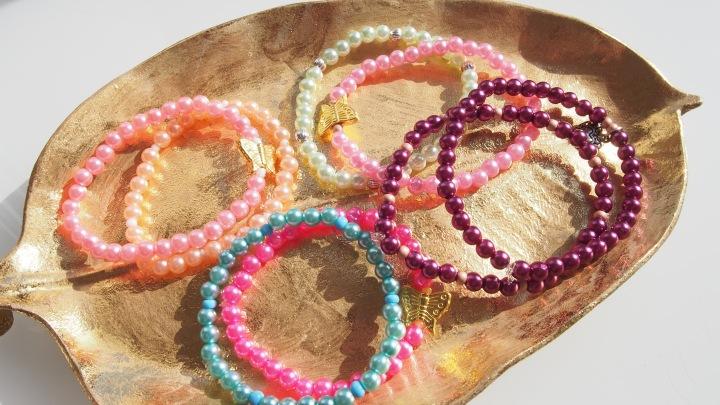 DIY-ing bracelets.